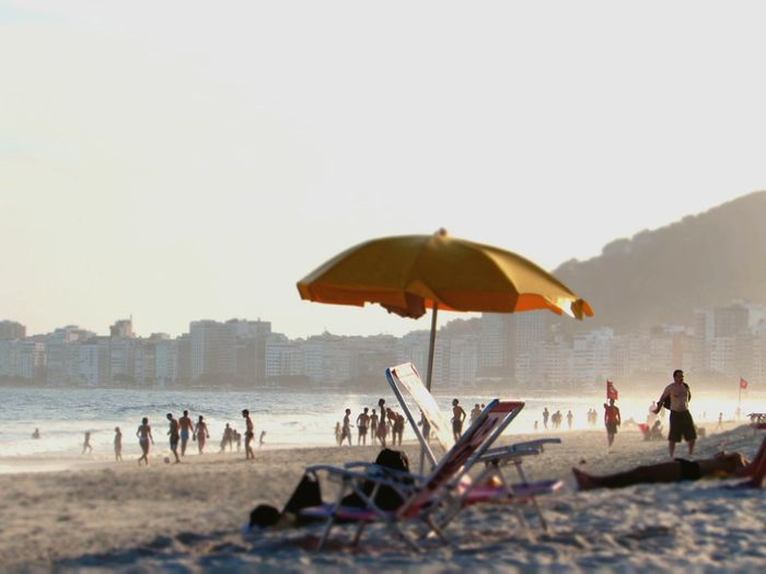 Final de tarde, Rio de Janeiro Beach Sea Sand Vacations Sunshade Summer Water Nature Outdoors Sky Day Men People Adult Beauty In Nature Adults Only Only Men