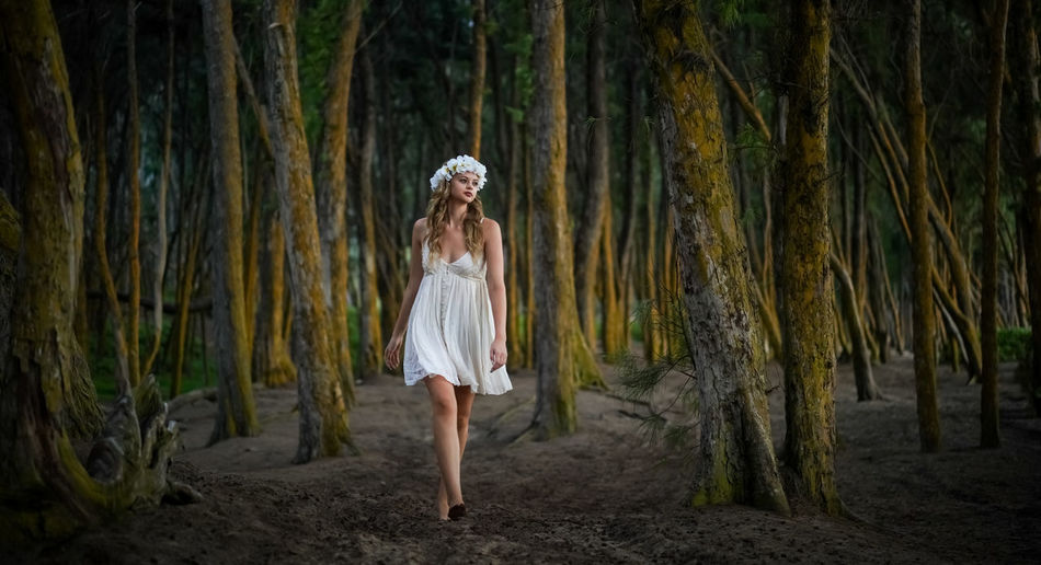 Woman standing in forest