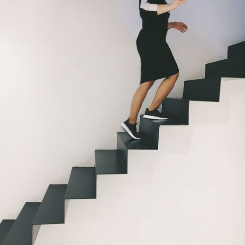 up up she goes Staircase Steps And Staircases One Person Lifestyles Indoors  Nike Shoes White Background Young Women Steps Stairways Stairway Breathing Space