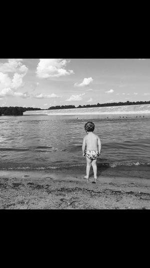 Childhood Sky Sea Water Beach Land Rear View Real People