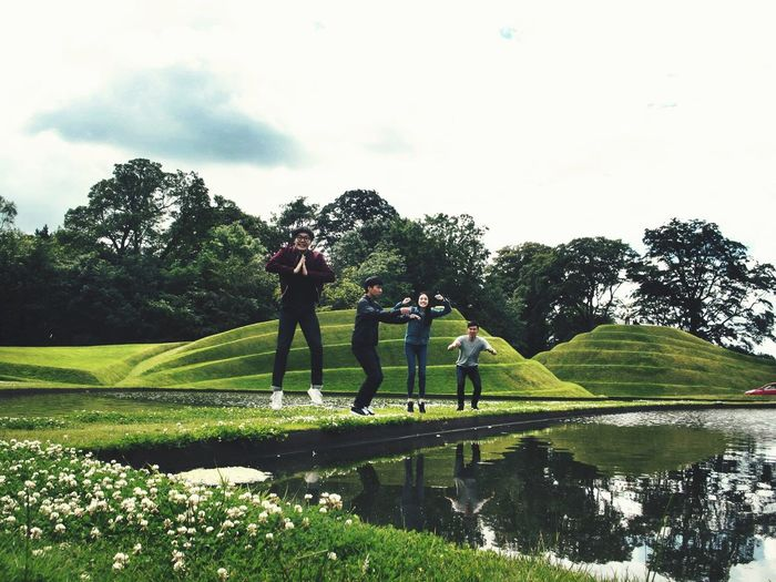 Jupiter Artland Full Length Tree Real People Standing Green Color Day Growth Leisure Activity Togetherness Outdoors Grass Sky People Adult Travel Destinations Enjoy The New Normal Travel Happiness Lifestyles Smiling Nature Friends