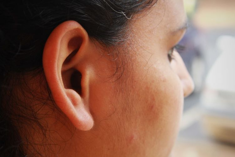 Cropped image of woman ear