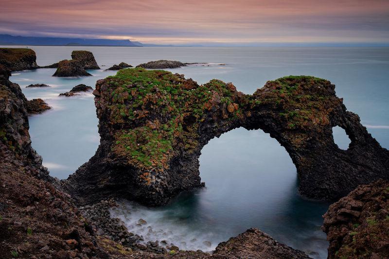 Long exposure of Gatklettur arch rock near Hellnar ,Snaefellsnes Peninsula ,Iceland. Arnastapi Beauty In Nature Horizon Over Water Long Exposure No People Outdoors Peninsula Rock Scenics - Nature Sea Tranquil Scene Water