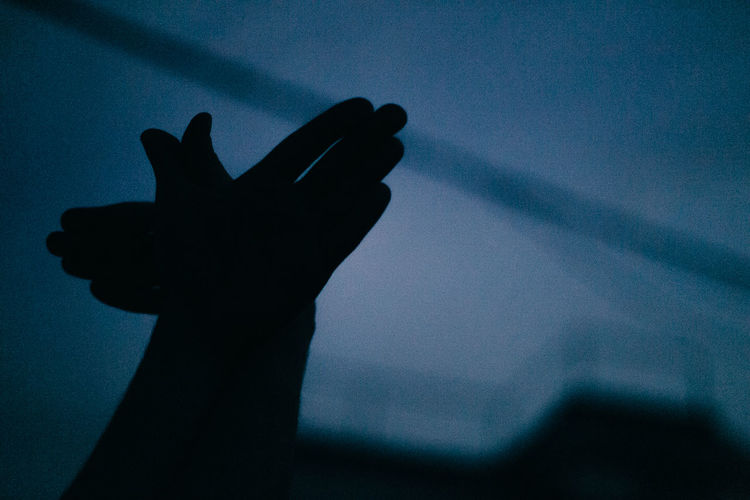 Low angle view of silhouette hand