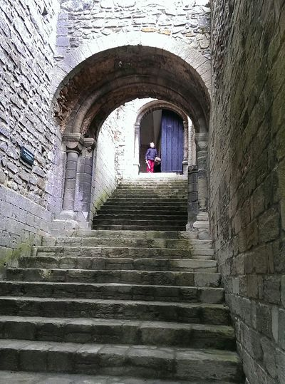 Steps leading towards archway
