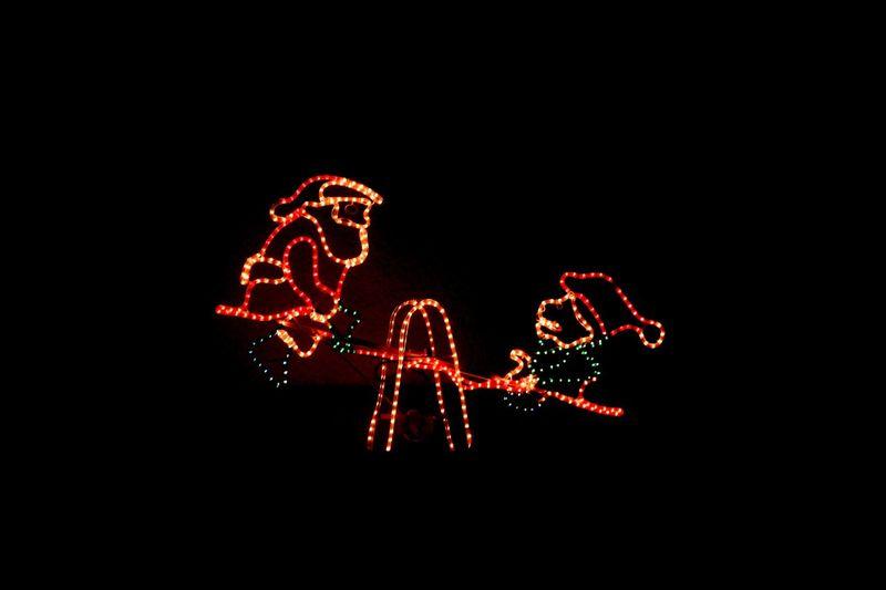 Ho ho ho Night Illuminated Celebration Copy Space Black Background Christmas Decoration Arts Culture And Entertainment No People Outdoors