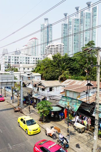Bangkok City Life Clear Sky Old And New Buildings Quonset Huts In The Foreground Skyscapers In The Background Sony A6000 Telephone And Electric Cables The Poor And The Rich Wiring  Yellow And Pink Taxi