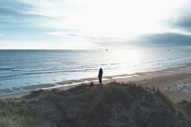 Paws for reflection Balmedie Beach Aberdeenshire Scotland Waves Man Young Man Scotland Dunes Beach Sea Sand Horizon Over Water Silhouette One Person Landscape Outdoors Standing Vacations Tranquil Scene Water Sky Tranquility