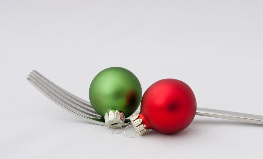 Still Life Indoors  Studio Shot White Background Copy Space Close-up Kitchen Utensil Fork Christmas Christmas Decoration Christmas Ornament Holiday Celebration Merry Christmas! Restaraunt Catering Eating Food And Drink Backgrounds Christmas Decorations Holidays Holiday - Event Ball