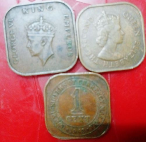 Malaya &British Borneo Coins Close-up No People My Hobby Collection 1 Cent King George VI Queen Elizabeth  Square Shape Coins On The Table Togetherness Not For Sale Leisure Activity