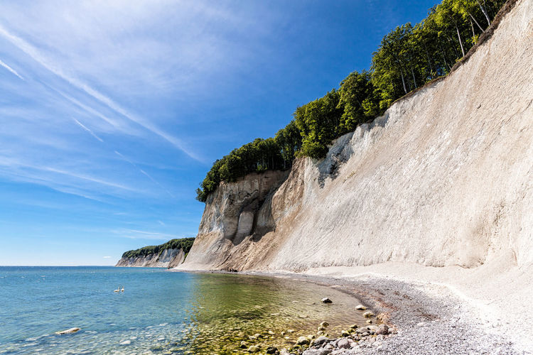 Baltic Sea coast on the island Ruegen, Germany. Baltic Sea Beach Beauty In Nature Chalk Cliffs Cliff Day Holiday Landscape Nature No People Outdoors Rock - Object Ruegen Sand Sassnitz Scenics Sea Summer Tourism Travel Travel Destinations Vacation Water White Cliffs
