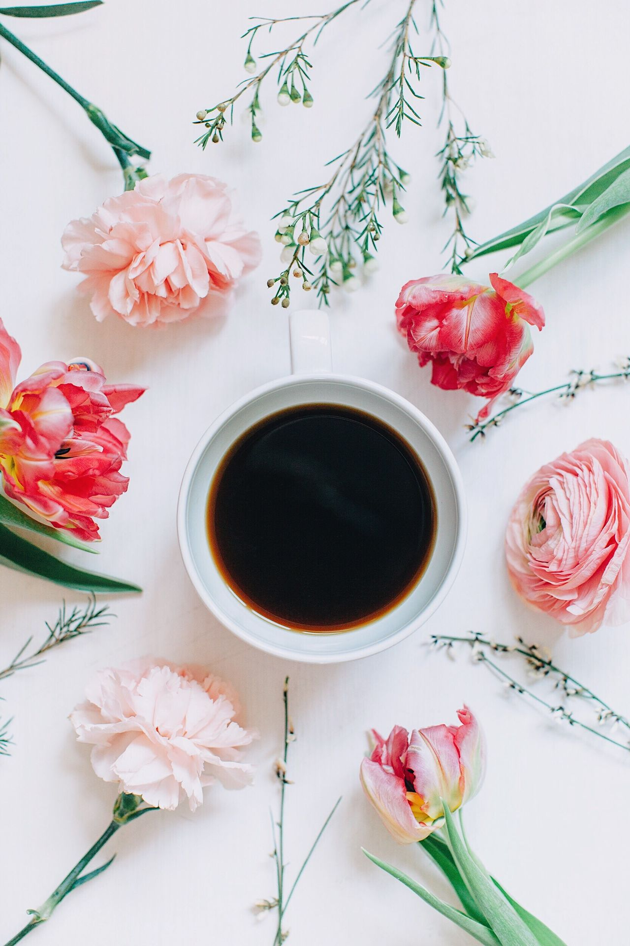 Directly above shot of flowers and coffee