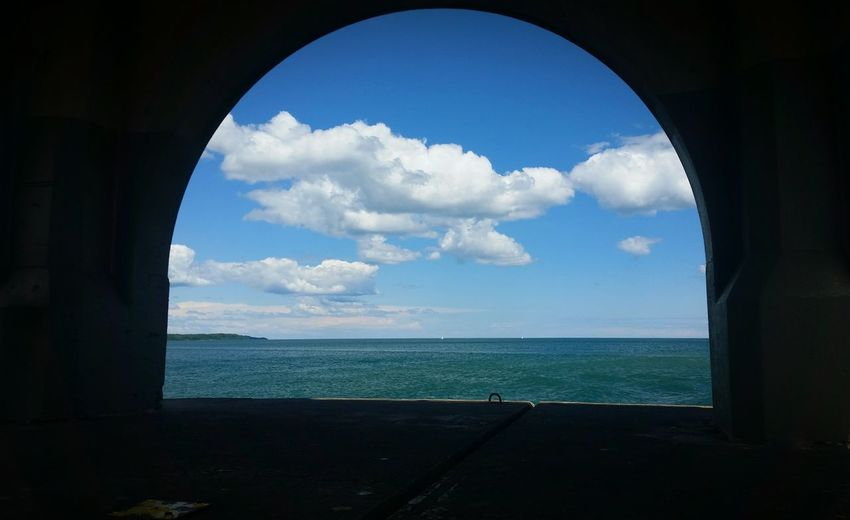 Cloud - Sky Sea Arch Sky Water No People Day Architecture Travel Destinations Horizon Over Water Nature Light House Light House And Blue Sky Lake Michigan First Eyeem Photo