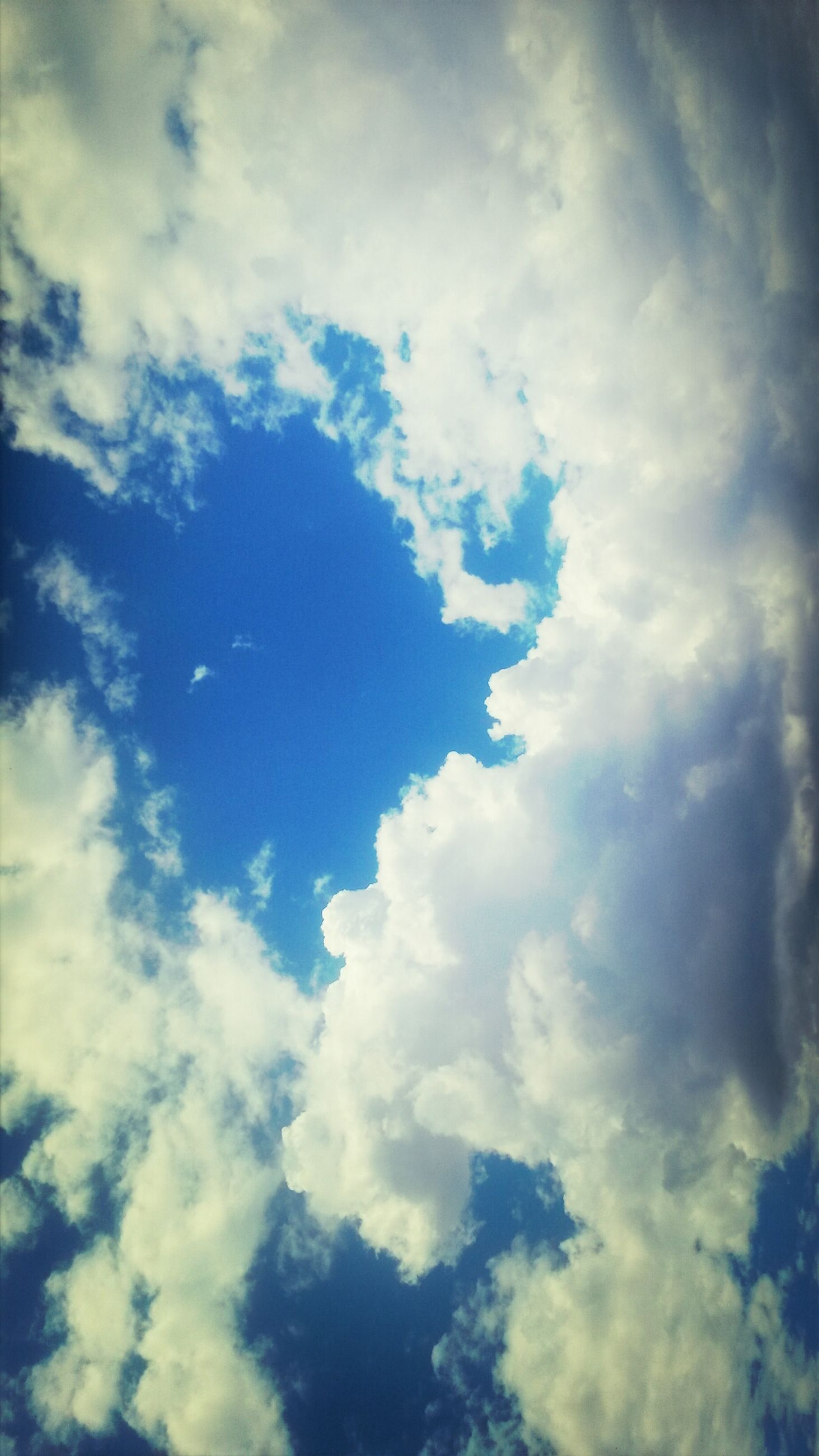 sky, low angle view, cloud - sky, cloudy, sky only, beauty in nature, tranquility, scenics, nature, backgrounds, cloudscape, tranquil scene, full frame, cloud, blue, idyllic, weather, outdoors, white color, no people