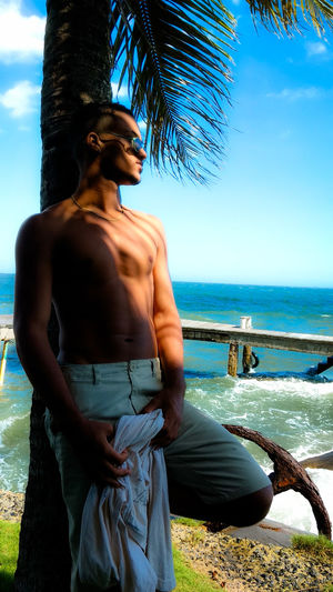 Ensaio de Pedro Guilherme Topmodel  Top View Eyeem Market Body & Fitness Body Shot Back Human Back Sea Beach Beauty Standing Females Shirtless Tree Women Seascape Palm Frond Calm Tropical Tree Palm Leaf Coconut Palm Tree Horizon Over Water Ocean Island Coast Coastline Tropical Climate Palm Tree