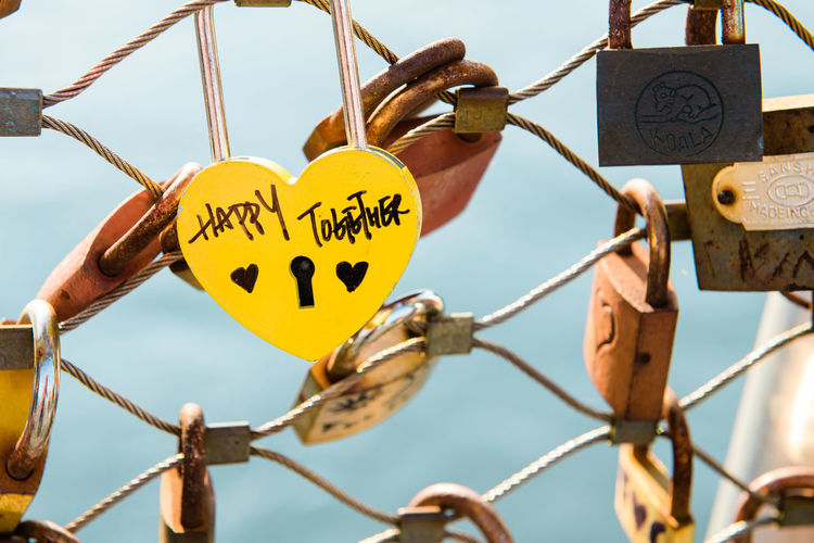 Love Lock Communication Focus On Foreground Padlock Love Lock Text Hanging Positive Emotion Safety Close-up Day Emotion Heart Shape Metal Love Lock No People Security Protection Hope - Concept Connection Outdoors Love Lock Bridge