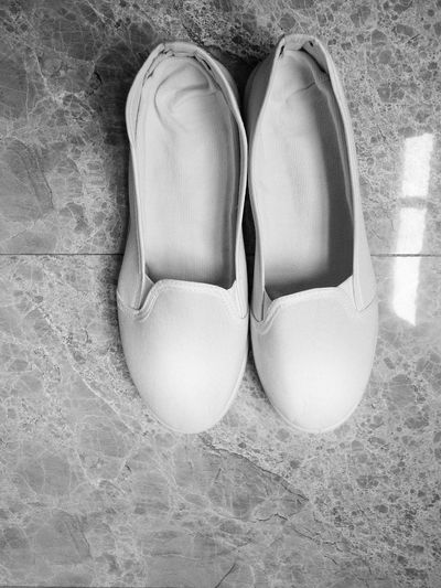EyeEm Selects Pair High Angle View Shoe No People Indoors  Sand Day Close-up Nurseslife White Shoes Black And White Black And White Photography Marble Floors Apparel Footwear