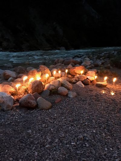 Burning Flame Illuminated Night Candle No People Outdoors Nature River Stones Riverbank Candles In The Night Glowing Summer The Week On EyeEm