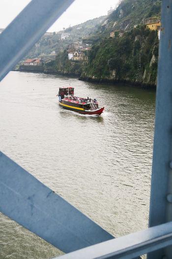 Tourist boat on the Douro river in porto, portugal Boat Trip Nautic Vessel Toursim Boat Douro River Bridges Run Water Attraction Nautical Vessel High Angle View