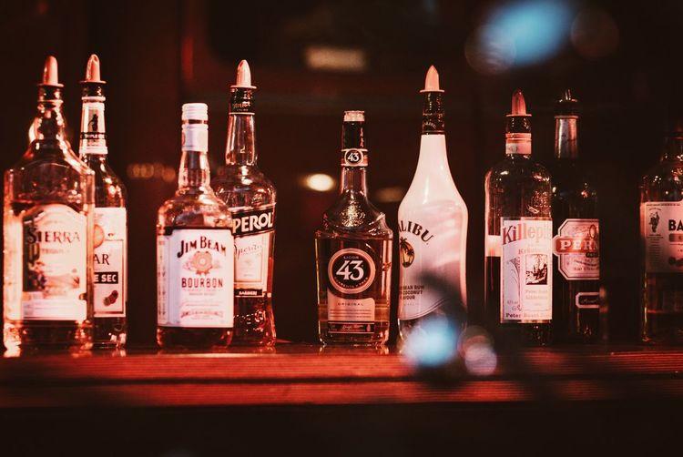 View of bottles in shelf
