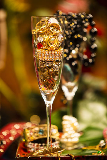 Celebrational Abundance Abundance Wealth Celebration Decoration Jewelry Pearls Glass Focus On Foreground Food And Drink Alcohol Refreshment Drink Wine Wineglass Food Close-up Table No People Still Life Drinking Glass Glass - Material Freshness Champagne Flute Transparent Indoors  Champagne