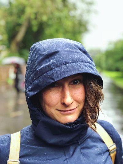 Portrait Of Smiling Woman Wearing Raincoat