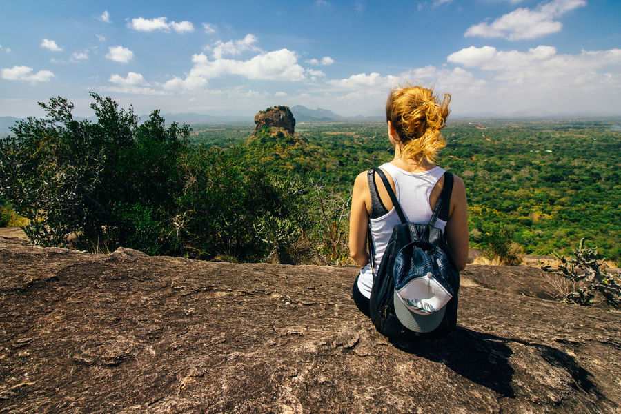 A girl viewing Sigiriya from Pidurangala rock Adults Only Adventure Beauty In Nature Endlesssummer Landscape Nature One Person One Woman Only Only Women Outdoors Pidurangala Rear View Sigiriya Sigiriya Rock Sitting Sri Lanka Young Adult