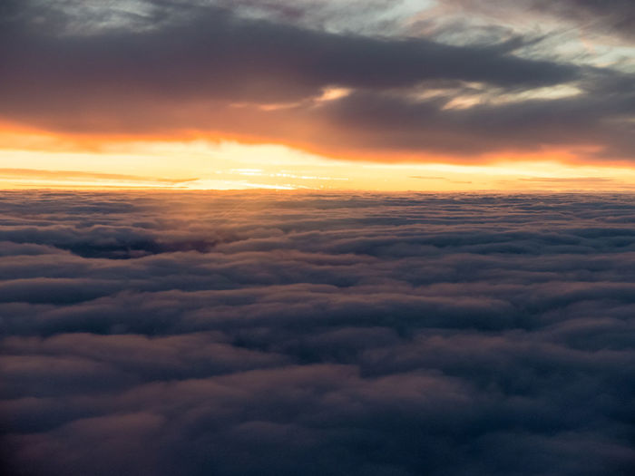Aerial View Beauty In Nature Cloud - Sky Clouds And Sky Cloudscape Cloudscape Dawn Dawn Of A New Day Day Dramatic Sky Flying Heaven Idyllic Lens Flare No People Orange Color Orange Sky Outdoors Scenics Sky Sky Only Sunrise Tranquil Scene