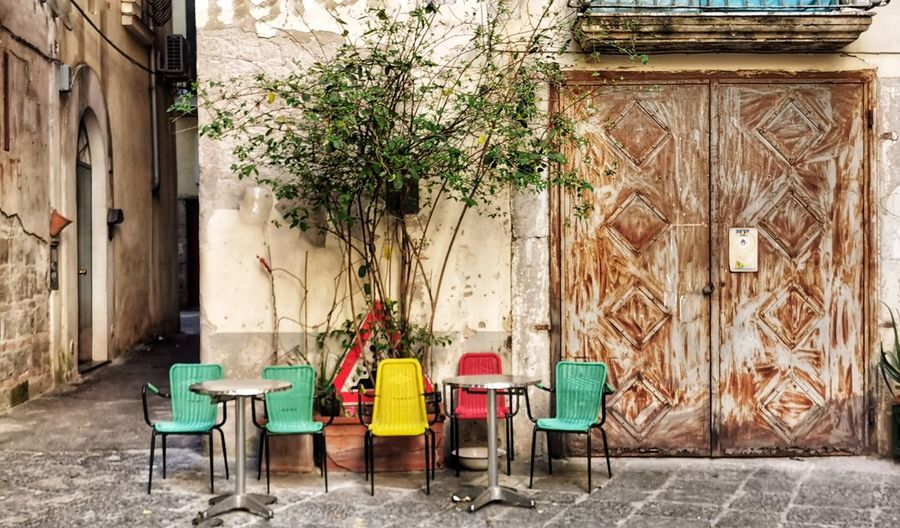 Chairs and table against building