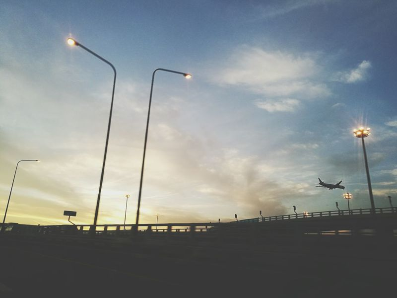 ON THE WAY Street Light Sky Dramatic Sky Sunset Cloud - Sky No People Airplane Toll Road Lighting Equipment Outdoors Day