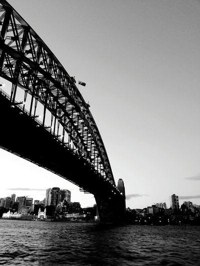 Low Angle View Of Sydney Harbor Bridge Over Sea