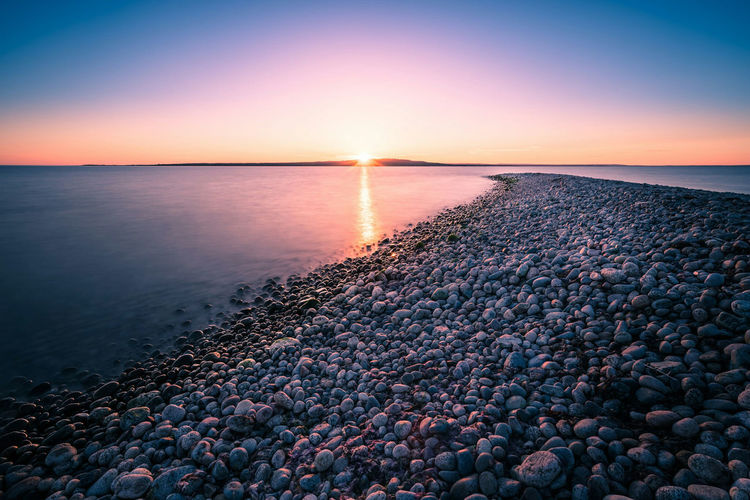 The road to the sun. Pebble Water Stone - Object Sunset Tranquil Scene Sea Scenics Beach Horizon Over Water Reflection Beauty In Nature Seascape Tranquility Sun Coastline Pebble Beach Nature Stone Shore Idyllic Beauty In Nature Sweden Water Surface Hano Ocean Live For The Story Sommergefühle