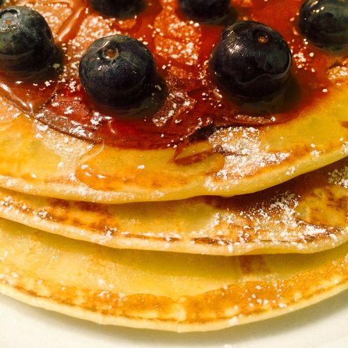 Close-up of pancakes with blueberries and honey