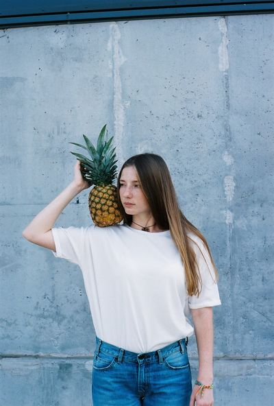 35mm 35mm Film 35mmfilmphotography Casual Film Kodak Pineapple Portrait Of A Woman Adult Casual Clothing Concrete Wall Film Photography Freshness Front View Fruit Gingerhair One Person Outdoors People Portrait Tropical White Shirt Young Adult Young Woman Young Women