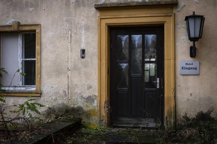 Closed door of old building, former hotel