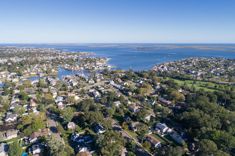 Aerial View Architecture Building Exterior Built Structure Cityscape Clear Sky Community Day High Angle View Horizon Horizon Over Water Landscape Nature No People Outdoors Patchwork Landscape Residential Building Scenics Sky Tree