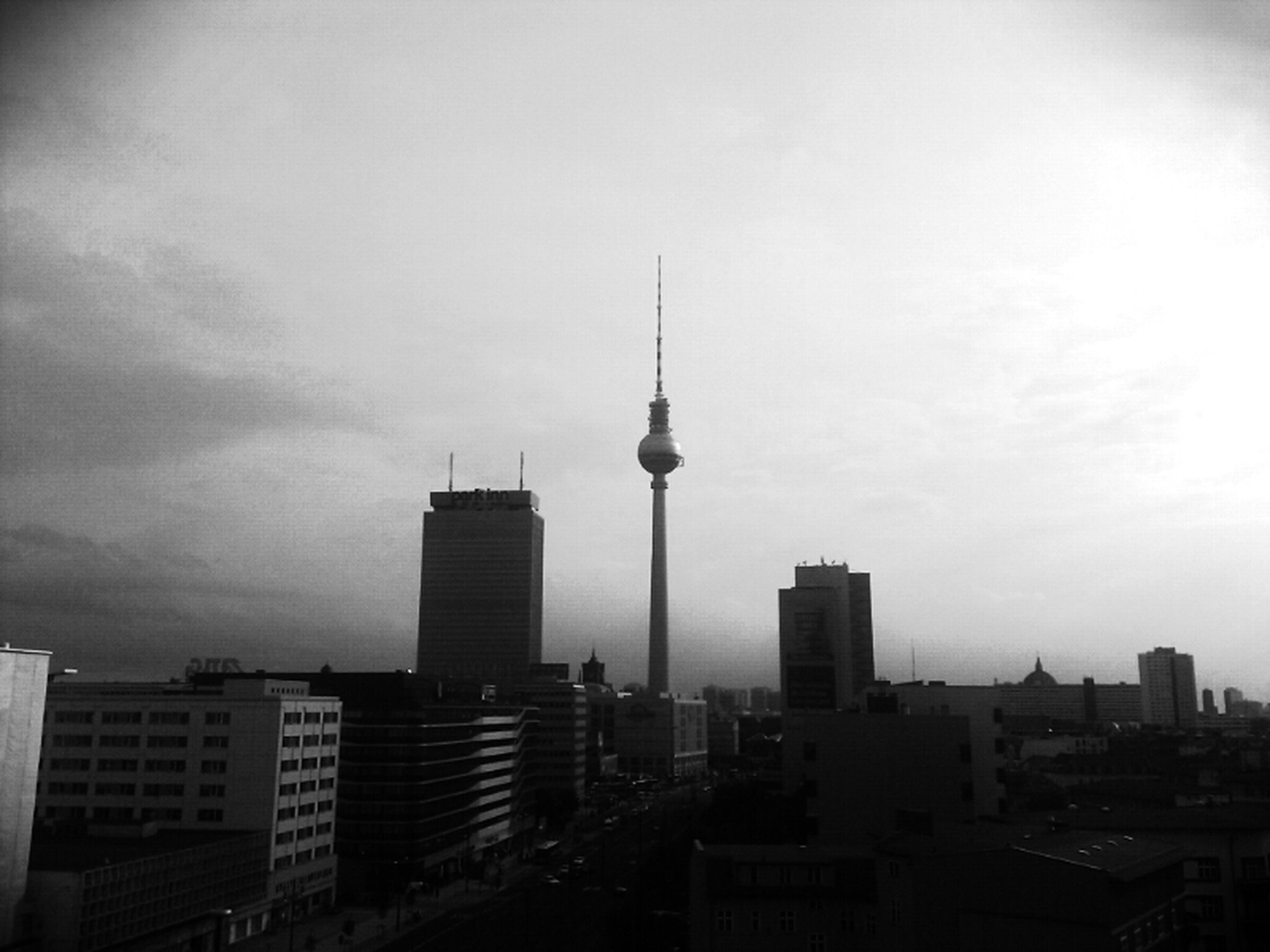 architecture, building exterior, built structure, tower, tall - high, city, communications tower, spire, skyscraper, capital cities, international landmark, fernsehturm, travel destinations, famous place, television tower, sky, tourism, cityscape, communication, travel