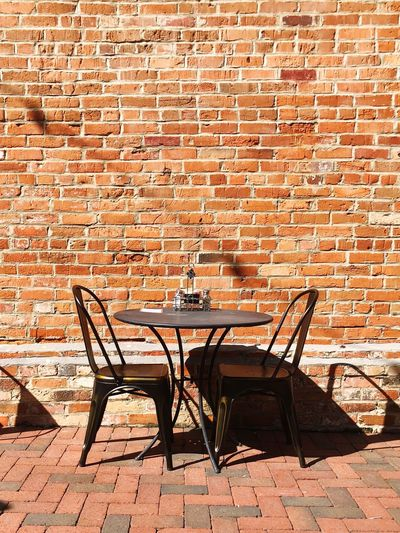Table for two Brick Brick Wall Wall Seat Chair Wall - Building Feature The Street Photographer - 2018 EyeEm Awards Architecture Sunlight Shadow Table No People Empty Absence Furniture