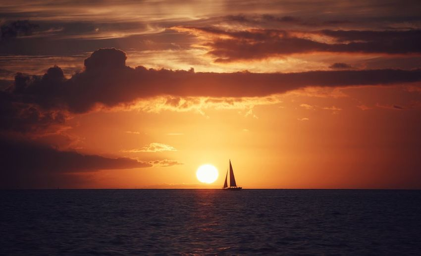 Sunset Sea Horizon Over Water Beauty In Nature Water Scenics Nature Sky Silhouette Sun Nautical Vessel Cloud - Sky Idyllic Sailing No People Outdoors Sailboat Yachting Peace Calm Serenity Travel Boat Sail Adventure