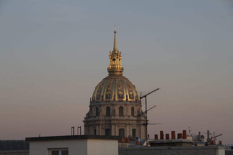 St-louis-des-invalides against sky during sunset in city