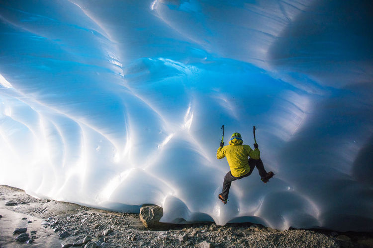Man surfing in sea during winter