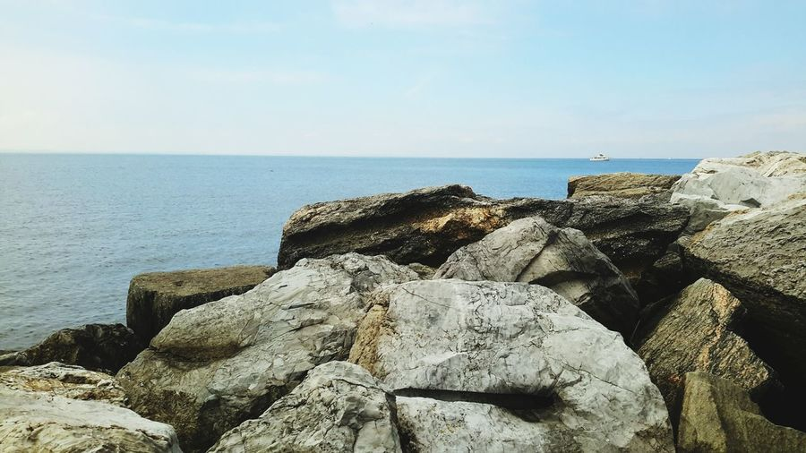 EyeEm Selects Manhattan Beach Brooklyn Nyc Beach Photography Outdoors Beauty In Nature No People Tranquil Scene Sea Horizon Over Water Beach Tranquility Rock - Object Water Nature Scenics Sky Day Sand Groyne