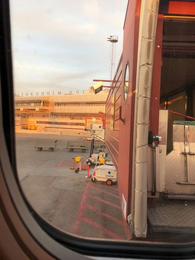 View of airport seen through train window