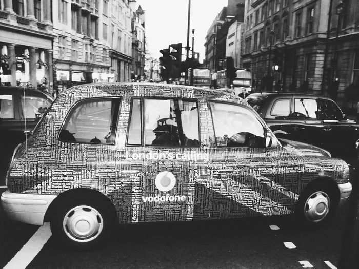 Close-up of car in city