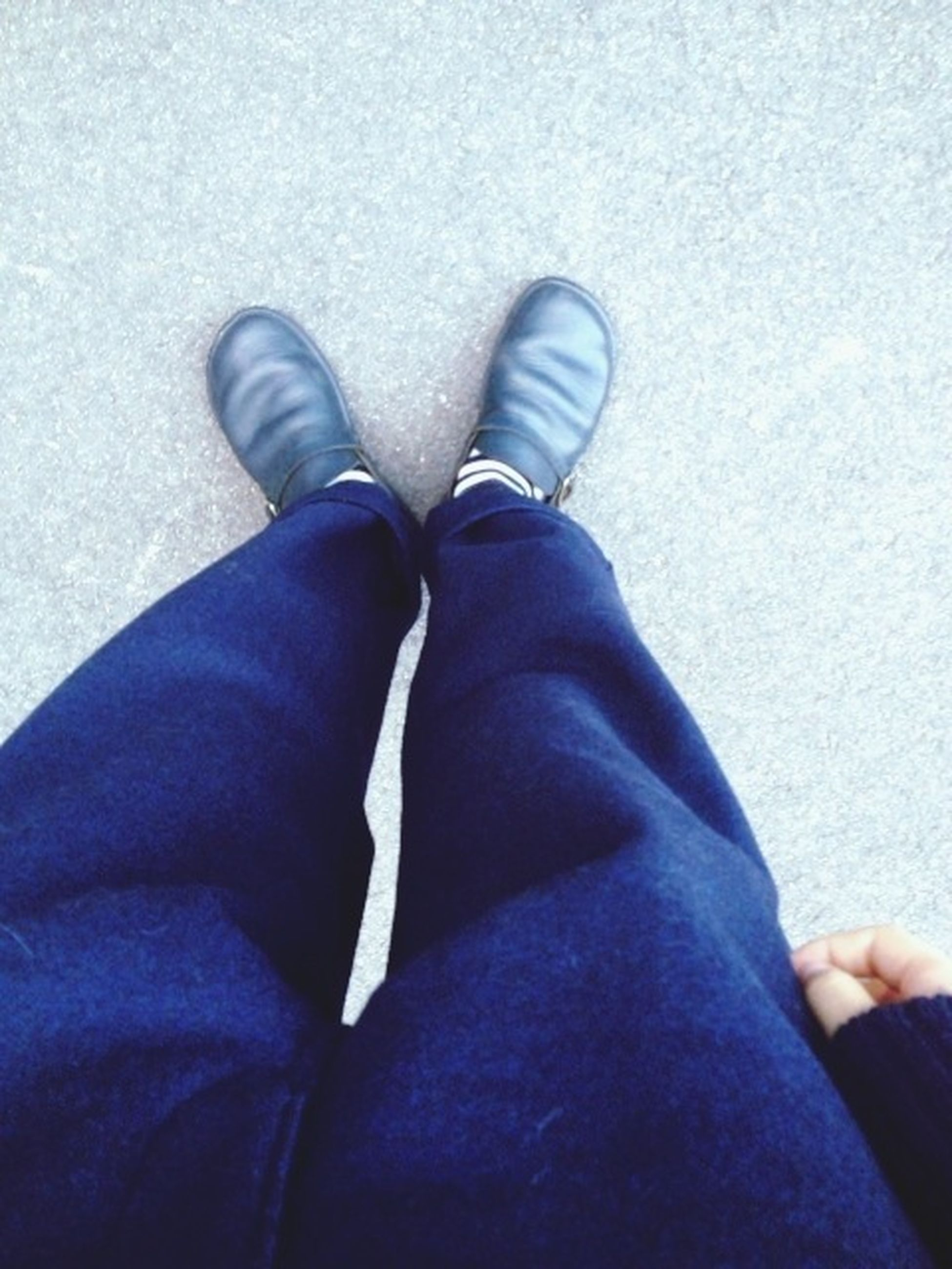 low section, person, jeans, personal perspective, shoe, lifestyles, casual clothing, human foot, standing, relaxation, high angle view, leisure activity, footwear, blue, sitting, men, legs crossed at ankle