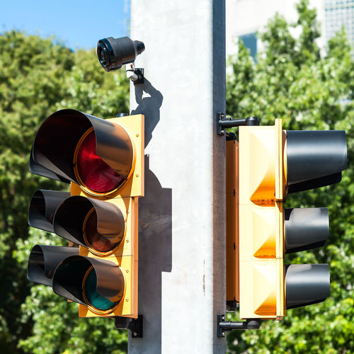 Traffic light with buzzer for walkway of the blind. Blind Traffic Transportation Buzzer Close-up Day Focus On Foreground No People Outdoors Protection Safety Sky Stoplight Tree Walkway Yellow