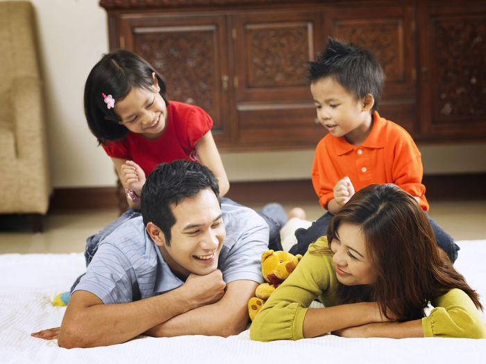 kid massaging thier parents Asian Family At Home Family Happiness Happy Love Bonding Cheerful Childhood Elementary Age Enjoying Life Enjoyment Family Time Group Of People Happiness Leisure Activity Lifestyles Massage Parent With Kids Parenting Real People Simple Life Smile Smiling Togetherness