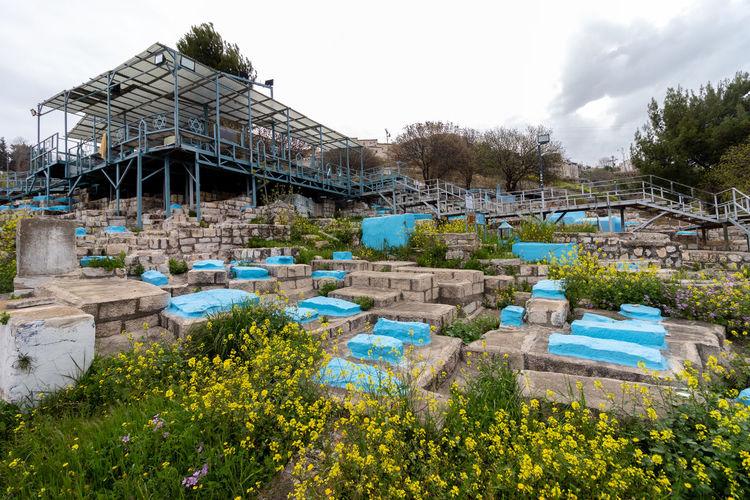 Built structure by plants against sky