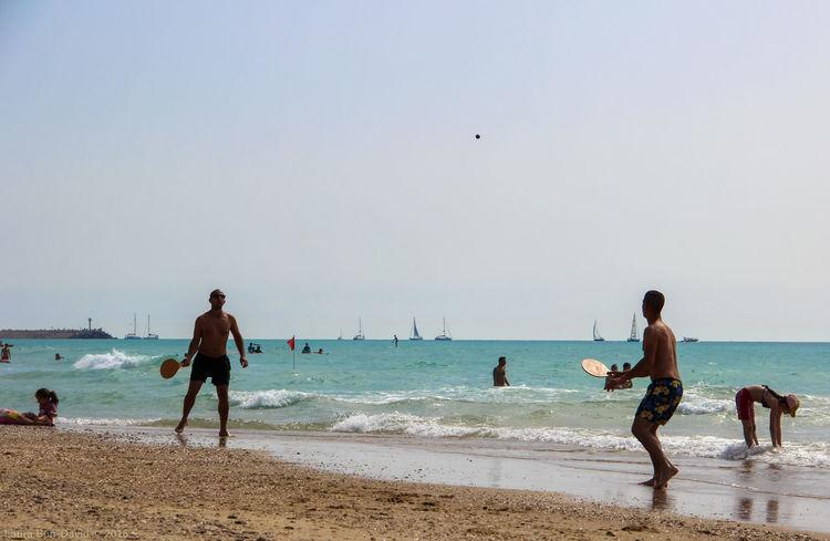Israelis playing matkot on the beach Beach Beach Sports Israel Israeli Beach Israelis Lifestyles Matkot Mediterranean  Mediterranean Coast Shore Summer First Eyeem Photo