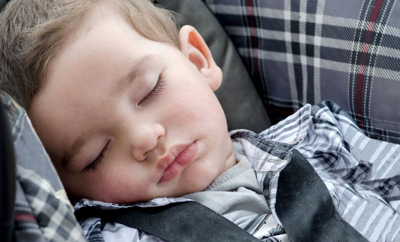 a sweet baby boy sleeps in his car seat Car Seat Angelic Baby Babyhood Bonding Child Child Safety Childhood Cute Eyes Closed  Family Headshot Hispanic Innocence Males  Portrait Positive Emotion Real People Recharging Relaxation Resting Sleeping Son Young Young Adult